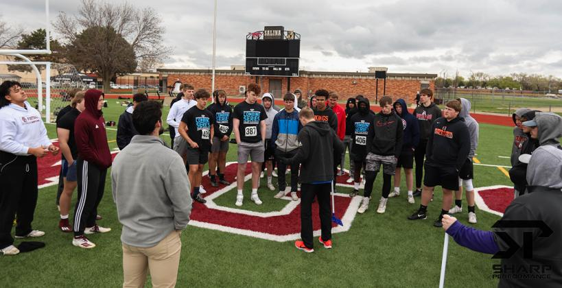 Athletes receive instruction on how to complete the standing broad jump test at last Saturday's Sharp Performance Combine. (Photo by Rayne Schmidtberger)