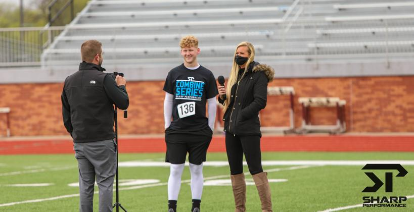 Hutch Trinity athlete Walt Gray - who will play football and attend school at Bishop Carroll this fall - is interviewed by Chet Kuplen and Bethany Bowman of Sports in Kansas at Saturday's Sharp Performance Combine. (Photo by Rayne Schmidtberger)