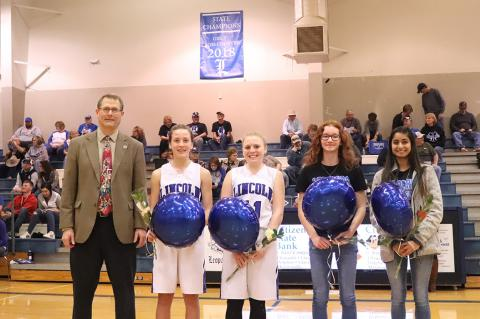 The Lincoln girls cross country team was honored for their 1A Cross Country Championship during Tuesday night's basketball games. Left-to-right: Coach Steve Crist, freshman Raegan Stewart, sophomore Jaycee Vath, freshman Shelbie Ford and senior Aubry Donley. (Photo courtesy Kae Hayworth)