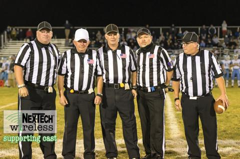 Veteran official Terrell Olson is flanked by the rest of his crew, including sons Travis and Troy, at his final game before retiring after a decades long career officiating high school sporting events in Kansas. (Photo by Karen Schroeder Photography)