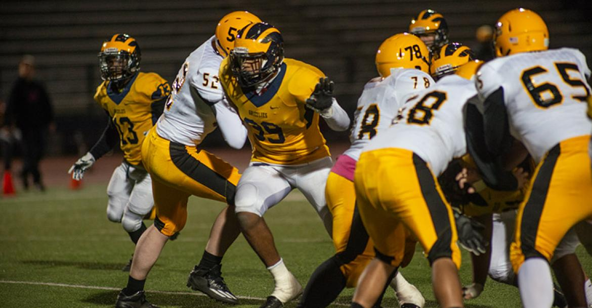 """Wichita Northwest defensive end Marcus Hicks (#99), part of our """"On the Front Lines"""" feature in 2017 and last year's """"Recruiting Kansas"""" feature, committed to the University of Oklahoma during the Early Signing Period. Hicks is also one of the top wrestlers and throwers in the Kansas. (Photo by Linda Gregory)"""