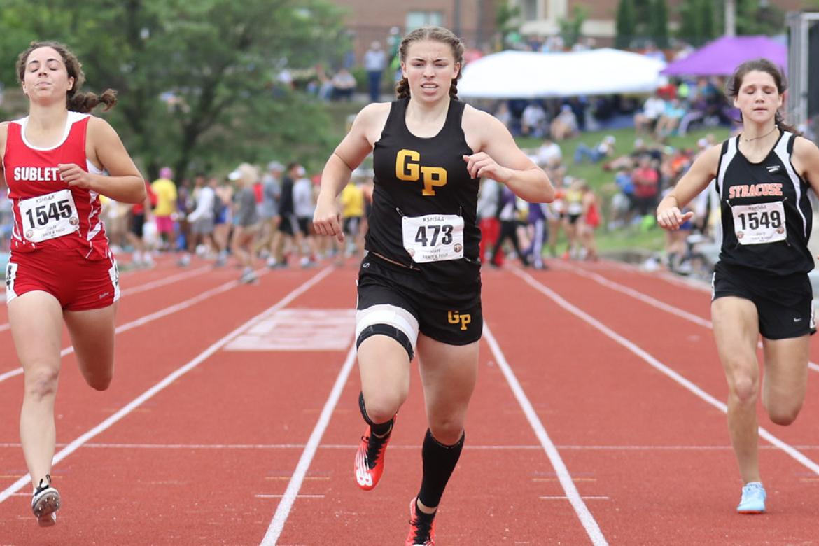 Garden Plain's Brooke Hammond (center) started off her high school track career in style earning gold medals in the 100, 200 and 400 relay in just her freshman season at May's Kansas State Track & Field Championships. (Photo by Huey Counts)